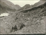 Klondikers and native packer near The Scales looking north toward the summit of Chilkoot Pass,...