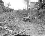 Looking east on Cherry St. from 4th Ave. showing regrade work, Seattle, Washington, February 1911.