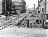 Looking north on 7th Ave. from Pine St. showing regrade work, Seattle, Washington, April 8, 1915.