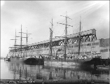 Sailing vessels W.B. FLINT and ST. FRANCES docked at an unidentified wharf on the East Waterway,...