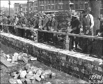 Men cleaning used bricks as part of a Civil Works Administration project, Seattle, Washington,...