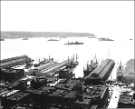 Looking west toward the harbor from vicinity of Railroad Ave. and Yesler Way, Seattle, Washington,...