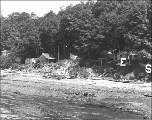 Houses and shacks on the shoreline in the vicinity of 28th Ave. W. near Smith's Cove, Seattle,...