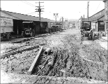 Looking north on 6th Ave. from Pine St. showing regrade work, Seattle, Washington, April 8, 1915.