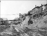 North view of 4th Ave. from Cherry St. showing regrade activities, Seattle, Washington, 1906.