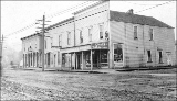 Businesses at southwest corner of N. 32nd St. and Fremont Ave., Seattle, Washington, ca. 1910.