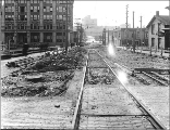 Looking west on Olive Way from 8th Ave. showing regrade work, Seattle, Washington, April 8, 1915.