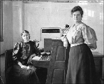 Two women working as telephone operators, King Street Station, Seattle, Washington, March 1907.