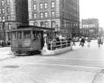 Looking west on Yesler Way from 3rd Ave. S. showing the Yesler Cable Car, Seattle, Washington,...
