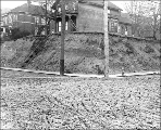 Residences and muddy street at northeast corner 5th Ave. and Cherry St., Seattle, Washington,...