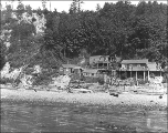 Houses and shacks on the shoreline between 26th Ave. W. and 28th Ave. W. near Smith's Cove,...