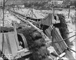 Battery St. between 5th Ave. and 6th Ave. showing conveyor carrying dirt from regrade work,...