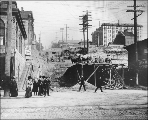Eastern view on Spring St. from 2nd Ave. showing regrade work, Seattle, Washington, 1904.