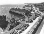 Construction of the Alaskan Way or Railroad Ave. seawall at University St., Seattle, Washington,...