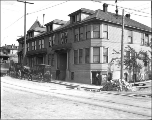 Businesses and apartments at E. Pike St. southeast corner of Bellevue Ave. E., Seattle,...