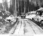 Victor Denny in automobile on west side of Snoqualmie Pass along the historic Sunset Highway, ca....