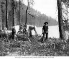 Lawrence Lindsley with horse, Keechelus Lake, 1901