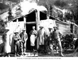 Mining crew, including Lawrence Lindsley, in front of miners' cabin, Ptarmigan Park, near Esther...