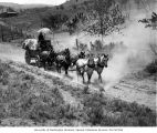 Freighting service showing horse drawn wagon, Chelan County, May 11, 1907