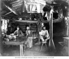 Roy Denny, Chas Rinn and Tom Record inside Esther Mine cabin at Ptarmigan Park, ca. 1907