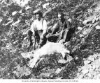 Roy Denny and Victor Denny mountain goat hunting on Big Ridge, north of Esther Mine cabin,...