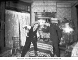Thomas Denny and Lawrence Lindsley posing as fighting gamblers at a house in the Fremont...
