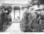 Curley, the dog, on front porch of Denny residence on Republican Street in Seattle, ca. 1890