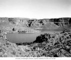 Dry Falls Lake with exposed rock walls showing seven layers of lava flows, May 14, 1938