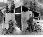 Trick photograph of two Lawrence Lindsleys at miners' cabin, Ptarmigan Park, near Esther Mines,...