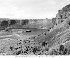 Dry Falls Lake with exposed rock wall showing seven layers of lava, July 3, 1938