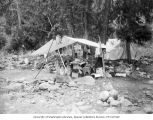 Campsite with tent and supplies on Railroad Creek, September 1915