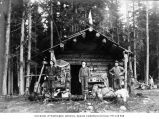 Victor Denny, William Denny and Dan Hines outside Esther Mine headquarters cabin at head of...