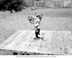 Thunder Bird totem and baby moccasins, 1960