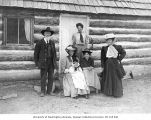 Lindsley's family posed in front of cabin, probably Lake Chelan, September 13, 1907