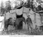 Lawrence Lindsley with horse preparing to leave camp for Lake Keechelus, October 1898