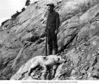 Victor Denny with rifle and and dead mountain goat, Kittitas County, 1901