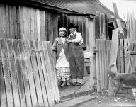 Snoqualmie couple standing outside their home, 1939