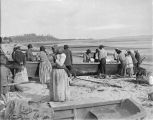 Indians preparing to launch a canoe at Port Townsend, August 30, 1899