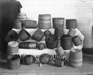 Tlingit baskets displayed on Salish blanket at the Ferry Museum, Tacoma, Washington, ca.1911
