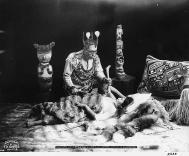 Tlingit healer and patient in posed healing ceremony, Alaska, 1906