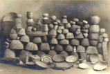 Indian baskets stacked for display in studio, Sedro Wooley, Washington, ca. 1900.