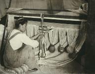 Woman weaving a Chilkat blanket, Alaska, ca. 1905