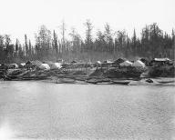 Athapascan [Salishan?] village on the Yukon River, Alaska, ca. 1907