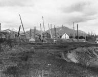 Gitksan totem poles, grave houses and dwellings, Kitwancool, British Columbia, 1910