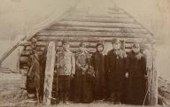 Chilkat family poses in front of cabin, Dyea, Alaska, ca. 1903