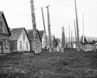 Gitksan totem poles and houses in village of Kispiox, British Columbia, 1909