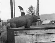 Gitksan totem of grizzly bear with fin on back, Kispiox, British Columbia, 1909