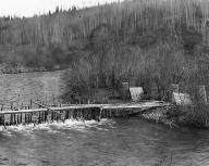 Gitksan fish trap and baskets beside Skeena River, British Columbia, 1910