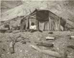 Tlingit seal hunter's hut on the beach, Glacier Bay, Alaska, 1899