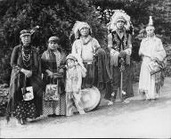 Tulalip family in ceremonial dress pose in Volunteer Park, Seattle, Washington, 1938